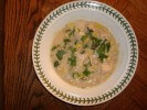 White Chicken Chili garnished with cilantro and lime