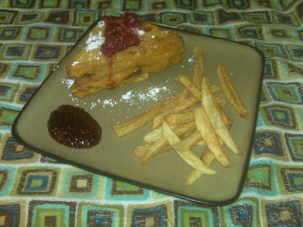 Caption: Monte Cristo sandwich with raspberries, raspberry jam and home made fries