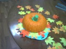 I used buttercream frosting with 1/3 cup cocoa and a green ice cream cone to make this cake look like a pumpkin.