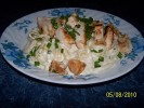 Alfredo Sauce Supreme was used to create this dish. Topped with Grilled Chicken and garnished with fresh garden chives.