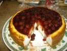 I made this Cheesecake for my husband\'s birthday, and topped it with a canned cherry pie filling, he really loved it.